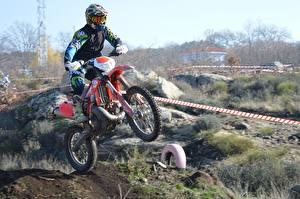 Обои Мотокросс Шлем Мотоциклист Скорость спортивный