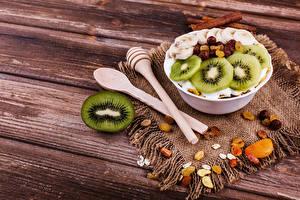 Фотография Мюсли Киви Изюм Доски Завтрак Ложка Пища