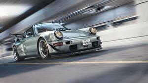 Фотография Porsche Едущий 964 RWB CGI авто