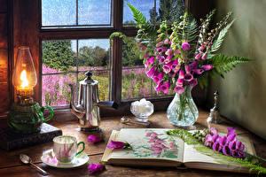 Фотография Натюрморт Наперстянка Керосиновая лампа Чайник Ваза Книги Чашка Цветы Еда