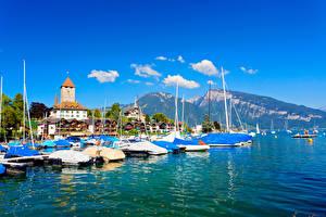 Картинки Швейцария Горы Здания Озеро Пристань Thunersee Thun Города