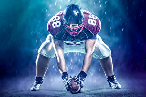 Картинки Американский футбол Мужчины Униформа Шлем Мяч Спорт