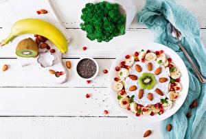 Обои для рабочего стола Десерт Желе Фрукты Орехи Киви Бананы Гранат Доски Зерна Продукты питания
