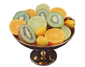 Фотографии Фрукты Киви Апельсин Лимоны Белый фон Продукты питания