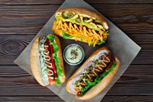 Картинки Хот-дог Булочки Овощи Сосиска Доски Втроем Пища