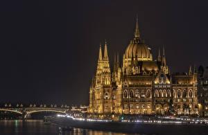 Фотографии Венгрия Будапешт Дома Реки Мосты Ночь Города