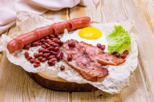 Фотографии Мясные продукты Сосиска Овощи Доски Зерна Яичница