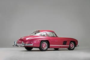 Картинка Mercedes-Benz Винтаж Сером фоне Розовый Металлик 1956 300 SL машина