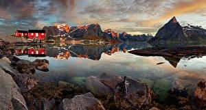 Фотография Норвегия Лофотенские острова Горы Здания Камни Деревня Reine Природа