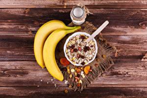 Фотография Бананы Мюсли Изюм Доски Завтрак Банке Еда