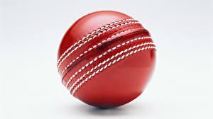 Картинка Крупным планом Мячик Красная Сером фоне Cricket Спорт