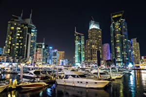 Обои ОАЭ Дубай Здания Пирсы Катера Корабли Ночью Города