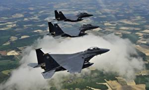 Обои для рабочего стола Самолеты Истребители Трое 3 Американский F-15E McDonnell Douglas 4th Fighter Wing Авиация