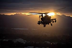 Фотографии Вертолеты Рассветы и закаты Летящий Американские Apache AH-64 Авиация