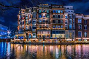 Фотографии Нидерланды Амстердам Здания Водный канал Ночь Города