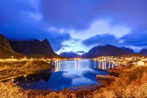 Картинка Норвегия Лофотенские острова Вечер Здания Осенние Гора Причалы Заливы Reine Города Природа
