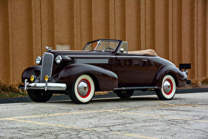 Фото Кадиллак Кабриолета Черная Металлик 1937 Series 60 Convertible Coupe by Fisher автомобиль