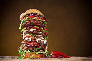 Картинки Быстрое питание Гамбургер Мясные продукты Острый перец чили Цветной фон