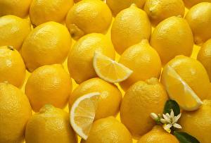 Обои для рабочего стола Лимоны Текстура Много Желтый Еда