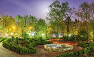 Картинки Россия Парк Весна Фонтаны Вечер Деревья Кусты Уличные фонари Sakhalin Природа