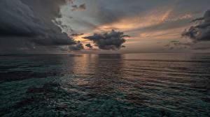 Фото Море Рассветы и закаты Облака Природа