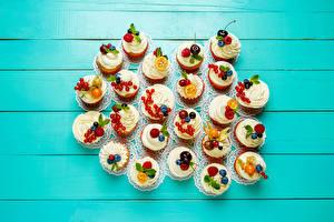 Фото Сладости Много Капкейк кекс Цветной фон Дизайн Продукты питания