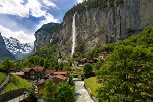 Картинка Швейцария Дома Водопады Реки Скалы Lauterbrunnen Города