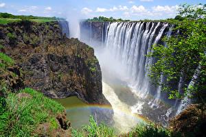 Фотография Водопады Каньоны Скала Радуга Rainbow Falls Victoria Falls Zambia Природа