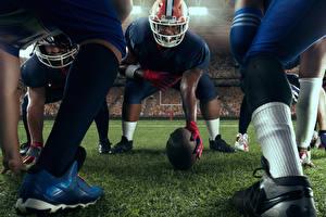 Картинка Американский футбол Мужчина Шлема Мяч Ноги спортивная