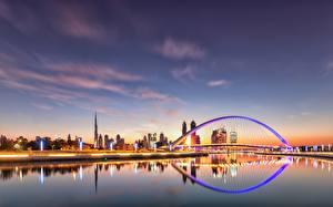 Картинка Вечер Небо Дубай ОАЭ Мосты Водный канал Города