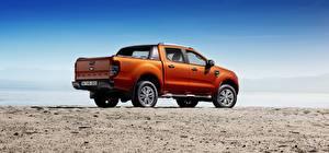 Обои Форд Пикап кузов Оранжевая Сбоку Ranger Wildtrak машина