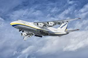 Фото Самолеты Транспортный самолёт Летит Antonov An-124-100 Авиация