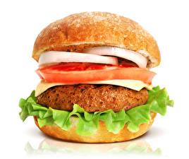 Фото Фастфуд Гамбургер Булочки Мясные продукты Овощи Крупным планом Белый фон Пища