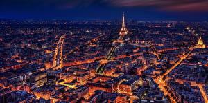 Обои Франция Здания Ночь Париже Башни Сверху Эйфелева башня Города