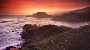 Фотографии Рассветы и закаты Море Побережье Камни Природа