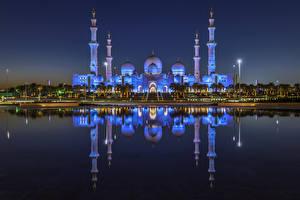 Обои для рабочего стола Объединённые Арабские Эмираты Здания Храмы Залив Ночь Отражении Abu Dhabi Города