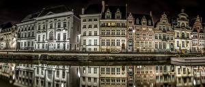 Картинки Гент Бельгия Дома Пирсы Водный канал Улице Ночь Уличные фонари город