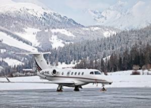 Обои Горы Зимние Леса Самолеты Швейцария Снега Dassault Falcon 50, St. Moritz, Airfield Авиация