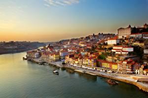 Обои Португалия Портус Кале Речка Рассвет и закат Здания Причалы Речные суда river Dora Города