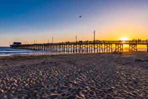 Фотографии Америка Рассветы и закаты Берег Мост Пляже Newport Beach Природа