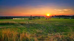 Картинка США Рассвет и закат Поля Сено Солнце Missouri Природа