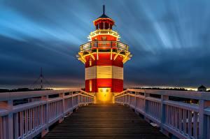 Картинки Маяк Вечер Германия Мосты Ограда Rheinsberg Lighthouse Города
