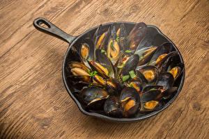 Фотография Морепродукты Доски Сковорода mussels