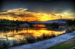 Картинки Испания Река Мост Рассветы и закаты Трава Zaragoza Aragon Природа