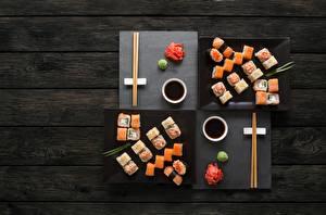 Фото Суси Рыба Палочки для еды Соевый соус Доски Продукты питания