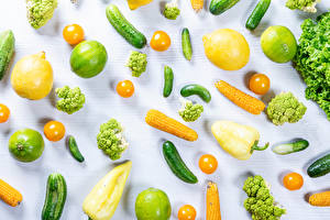Картинки Овощи Лимоны Кукуруза Лайм Огурцы Помидоры Перец Белый фон Broccoli