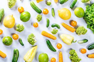Картинки Овощи Лимоны Кукуруза Лайм Огурцы Помидоры Перец Брокколи Белый фон