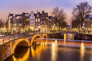 Картинка Мосты Вечер Здания Амстердам Голландия Водный канал
