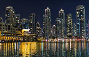 Обои Объединённые Арабские Эмираты Дубай Здания Пирсы Залива Ночные город