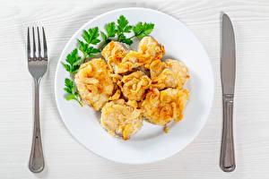 Фотографии Рыба Нож Тарелка Кусочки Вилки Продукты питания